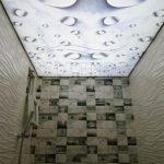 Полупрозрачный натяжной потолок с фотопечатью и запотолочной подсветкой.